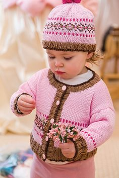 Both boys and girls look great in this Fair Isle cardigan and hat set. Instructions are given for a boy's and girl's colorway.