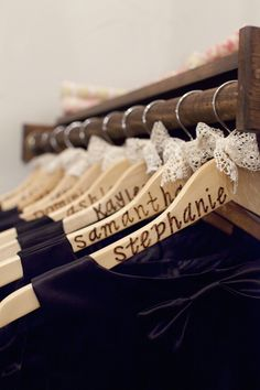 Keep track of bridesmaids' dresses. Paint and decorate hangers for them to take home...so cute!