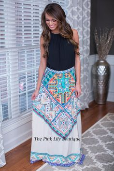 Get out of your comfort zone with this white printed maxi skirt! The flowy material makes it great for cool spring days and the overall look will have everyone envy of your style!