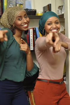 They're beautiful.   Love their style:  head scarf, earrings, colors.