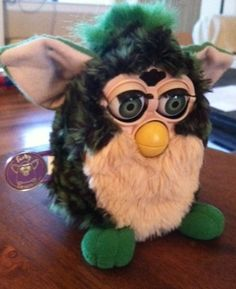 Original Furby - Black and Green Spots with Cream Belly (1999) by Furby, http://www.amazon.com/dp/B006JS2NDY/ref=cm_sw_r_pi_dp_u8C9rb1GY74J0