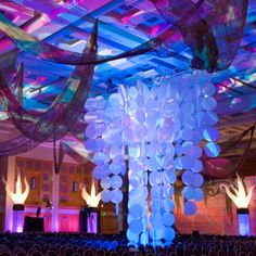 A dramatic ceiling treatmenet included a 30' chandelier and over 1,000 feet of erosion cloth - www.eventlab.net