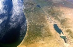 Aerial view of Israel.  The Mediterrenian, the Sea of galilee above and the Dead Sea below.