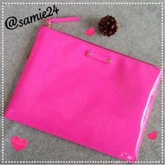 """kate♠spade Pink Pouch Authentic brand new tags. Bright pink large sized pouch/ clutch. 2 side slot pockets suitable for cell phones & mini wallet.  Carry all your essentials in this trendy clutch/pouch. Dimensions : 7 1/4"""" × 9 3/4"""" × 0.33"""". Shell & trim: 100% Polyvinyl.  Lining: 100% Polyester kate spade Bags Cosmetic Bags & Cases"""