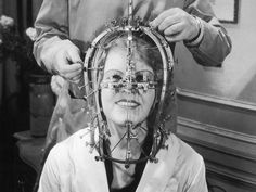 Max Factor takes precise measurements of the actress Marjorie Reynolds's head and face with a contraption that looks like an instrument of torture Photograph: Keystone-France/Getty Images