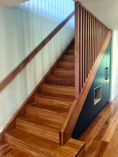 Blackbutt staircase with matching handrail and timber battens. Under stair storage cabinetry. Blackbutt staircase with matching handrail and timber battens. Under stair storage cabinetry. Stair Railing Design, Stair Handrail, Staircase Railings, Staircase Ideas, Timber Staircase, Stair Bannister Ideas, Wooden Staircase Design, Handrail Ideas, Timber Handrail