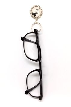 fd56970e3ac This black and white dragonfly eyeglass holder is magnetic. The black  dragonfly is hovering over
