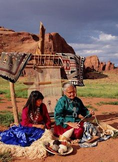 seated Navajo woman spinning wool thread in front of loom, accompanied by young girl watching. New Mexico Native American Beauty, American Indian Art, American Indians, American History, New Mexico Usa, Mexico Art, Cherokee, New Mexican, Land Of Enchantment