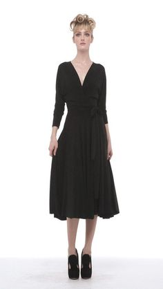This midi-length poly-lycra dress has long dolman sleeves, surplice neckline, full skirt, and an attached self-belt closure. This dress can worn two ways