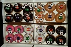 Monster donuts with marshmallow eyeballs and gummy mouths