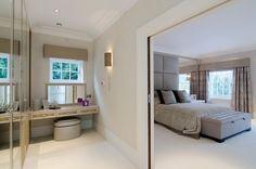 Master bedroom with bespoke headboard, stained birds-eye maple veneer, mirror and velvet upholstered panels
