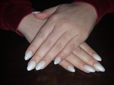 acrygel almond white nails with a spark of purple shimmer