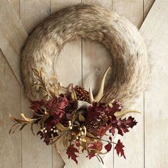 Here's one way to get the warm fuzzies this harvest season. Hang our exclusive wreath above your mantel, on your front door or in a hallway. Handcrafted with faux fur, pinecones and faux antlers, it softens up any area of your home with its welcoming look.
