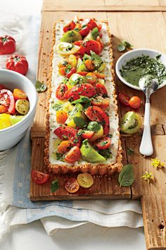 Tomato-Goat Cheese Tart with Lemon-Basil Vinaigrette | Make the most of summertime tomatoes with these sweet and savory tomato pie recipes.