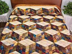 Lovely hand painted Batik style fabrics give the classic Tumbling Blocks design a whole new look! Another wonderful creation of C Jean Horst, a Lancaster County Amish woman.Hand Painted Tumbling Blocks Quilt -- exquisite handcrafted quilt from Lancaster Batik Quilts, 3d Quilts, Amish Quilts, Scrappy Quilts, Bargello Quilts, Colchas Quilting, Quilting Projects, Quilting Designs, Quilting Board