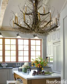 A show-stopping twig chandelier from Hudson Home brings a natural element, and some whimsy, inside an upstate New York house.