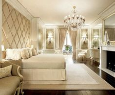 gorgeous master bedroom. Love that detail on the back wall.