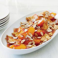 Crêpes with Warm Cognac Peaches and Almonds | MyRecipes.com ~ Filled with sweetened ricotta, these are excellent for brunch or dessert. These crêpes are simple to make and fill, and can be mostly done the day before.