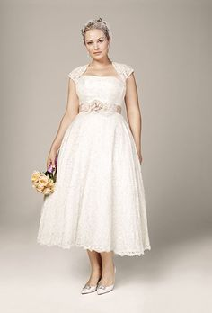 Brides.com: 21 Stylish, Short Plus-Size Wedding Dresses Style 9T9948, strapless tea-length gown with cap-sleeve shrug, $549, David's BridalPhoto: Courtesy of David's Bridal