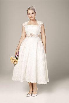 Brides.com: 21 Stylish, Short Plus-Size Wedding Dresses Style 9T9948, strapless tea-length gown with cap-sleeve shrug, $549, David's BridalPhoto: Courtesy of David's Bridal