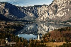 An elevated view of Lake Bohinj, Slovenia from the Vodnikov Razglednik viewpoint in snowless winter time