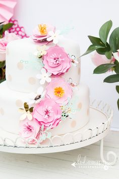 Handmade flowers for this beautiful party cake. By Jennifer Evans