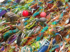 Scouring the Norfolk coastline for flotsam, Joanna collects fishing line, netting and other unexpected items for her colourful tapestries.  Initially the weavings are striking, but on realising they are comprised completely from marine debris, their existence becomes all the more alarming.