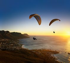 We love this paragliding image by Stuart Hall.  Freedom, escape, extreme sports, adventure, skill, thrill.  Not to mention, breathtaking.