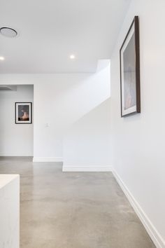 Concrete floors Mechanically polished concrete featuring nil stone exposure in a matte finish How To Polished Concrete Flooring, Concrete Tiles, Stained Concrete, Residential Concrete Floors, Finished Concrete Floors, Concrete Kitchen Floor, Concrete Countertops, Garage Boden, Interior Architecture