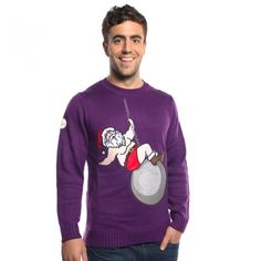 """This is what happens when Mrs. Claus breaks Santa's heart. Looks like he'll need more than a few glasses of eggnog to get through this one. Let's just hope this wrecking ball is nowhere near Santa's workshop. Let loose, belt your heart out, and sing along to the song we know is stuck in your head now in this purple Christmas jumper. """"I came in like a wrecking ball!"""" Does not come with Miley Cyrus!"""