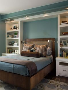 Boys room maybe? Lights on walls and built in book case surround.