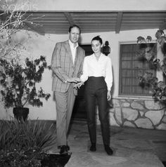Mel Ferrer helps his wife, actress Audrey Hepburn, take her first steps here Feb. 26th since she was injured in a fall from a horse during film-making in Durango, Mexico. She is on her way to a hospital for an X-ray check-up.