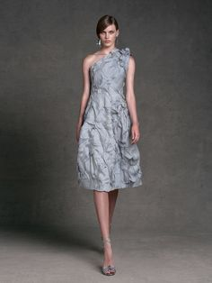 I love how this is a very classic style dress with the crumpled gray fabric, making it modern.