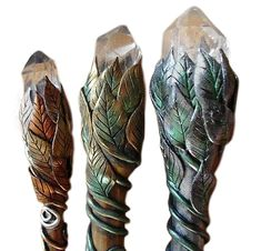 polymer clay wands or hair sticks, the leaves wrap around a crystal