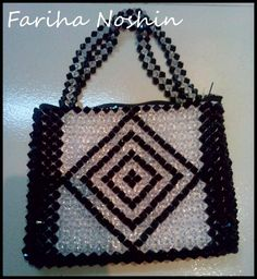 """Beautiful black&white purse"" Made out of:black & white crystal beads,plastic thread."