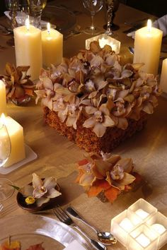 Orchids and candles put together by Preston Bailey