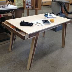 Walnut and plywood table by Nicole Levy, via Behance