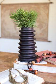 ribbed black clay cylinder