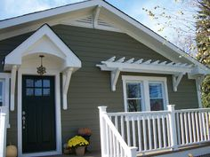 Sixty-Fifth Avenue: Craftsman style cottage with uncovered front porch, balanced by trellis.