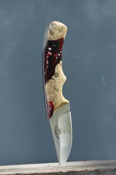 Wood and resin on stainless steel blade $160.