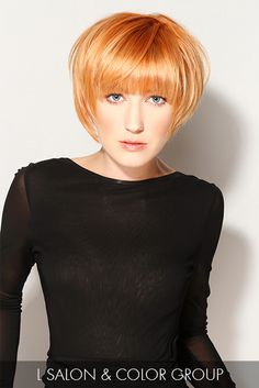 Heavy bangs and angled strands expose this model's delicate face shape and provide a lush landscape for a stunning copper hue.