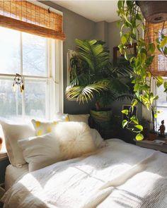 Bedroom inspiration. Blinds, plants and bedlinen.