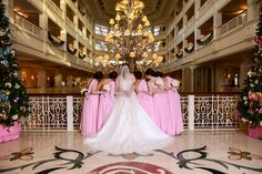 Jessi and her bridesmaids are looking lovely in pink at Disney's Grand Floridian Resort