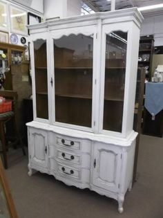 $285 - This is a large one piece French Provincial china cabinet - painted, distressed and waxed ***** In Booth D13 at Main Street Antique Mall 7260 E Main St (east of Power RD on MAIN STREET) Mesa Az 85207 **** Open 7 days a week 10:00AM-5:30PM **** Call for more information 480 924 1122 **** We Accept cash, debit, VISA,
