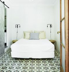 White rustic bedroom with geometric tiles