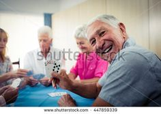 Group of seniors playing cards in the retirement house