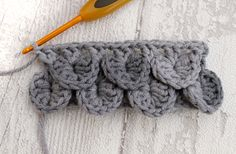 One of the crochet stitches that's important for the house bag is the crocodile stitch. Look, here it is, used for the roof of the house, which forms the flap for the bag:- It's not dif…