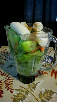 Apples, lemons, oranges, spinach, cilantro, banana, carrots, celery sprinkled with cayenne pepper and cinnamon = Green Crack! ;)
