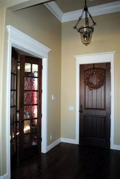 Stained Door White Trim Wonderfully Stained Trim with Painted Closet Doors Pinte… - Home Page Dark Doors, Brown Doors, Doors And Floors, Wood Doors, Entry Doors, Patio Doors, Entryway, Interior Barn Doors, Interior Exterior