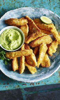 Crispy Coconut Chicken Strips with Avocado Coriander Dip